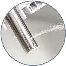 Close up shot of the bidet seat nozzle spraying water