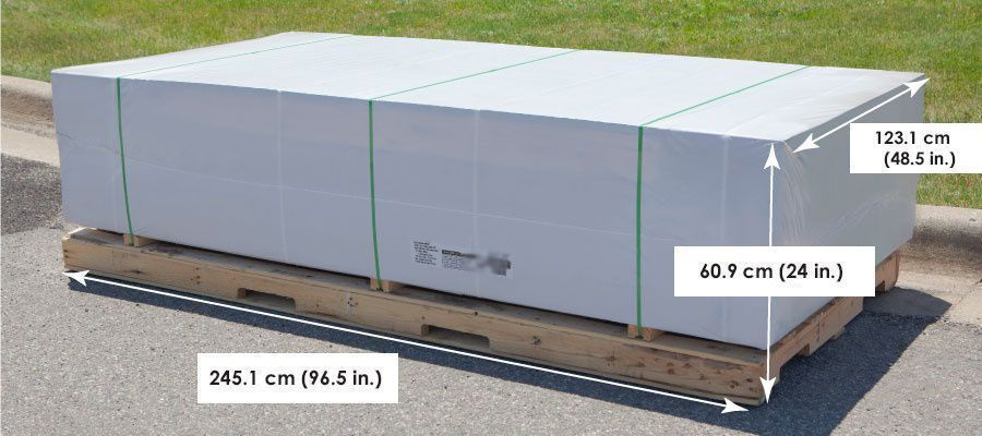 shed kits on curbside protected in shrink-wrap