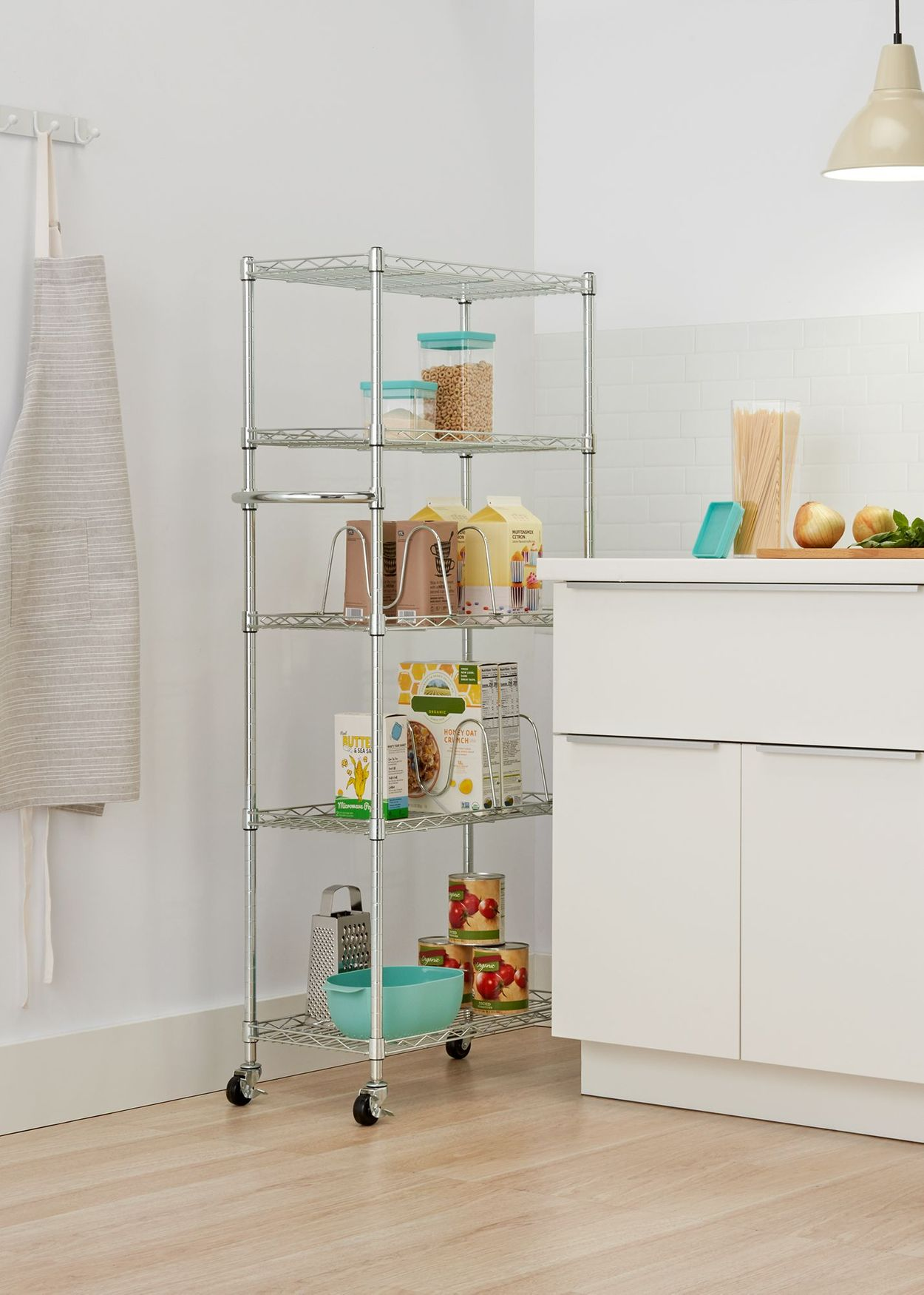 TRINITY Basics Pantry rack stored in between the wall and counters