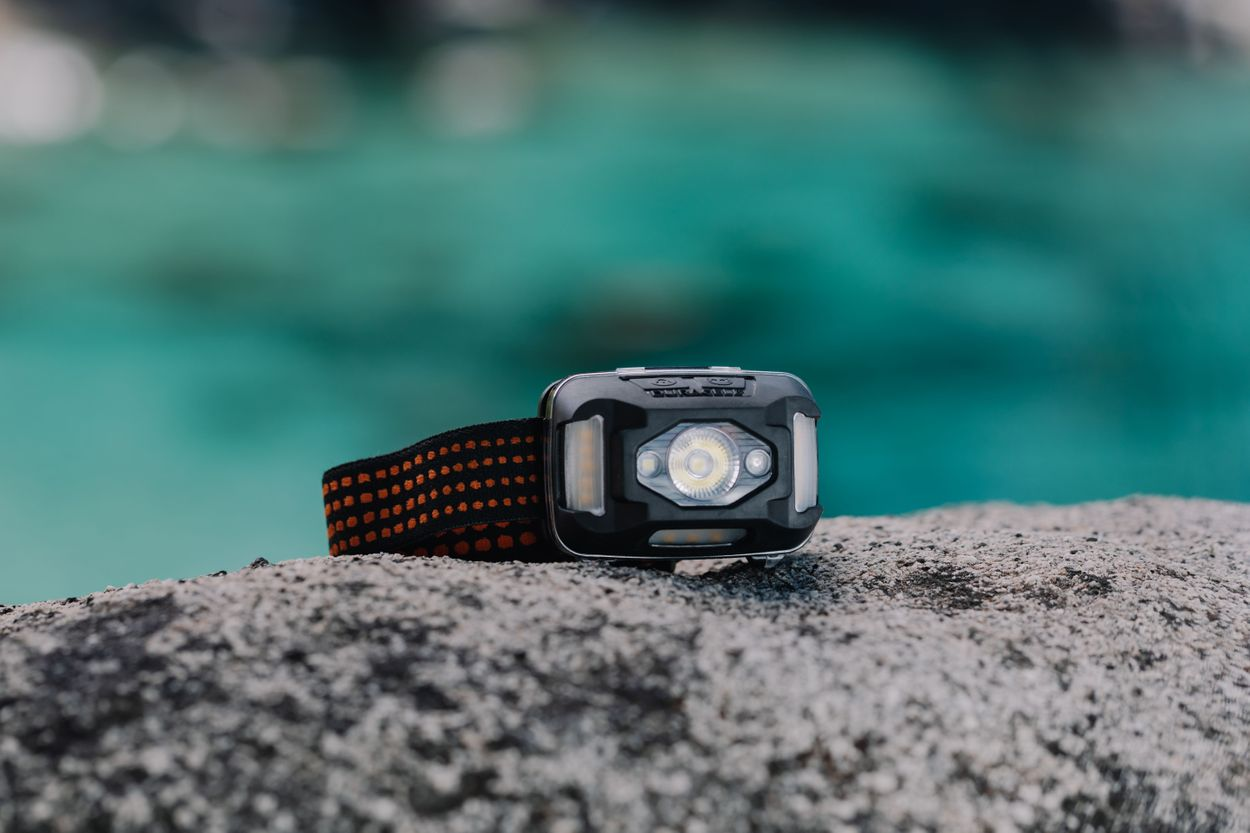 Image of the headlamp on a rock with water in the background